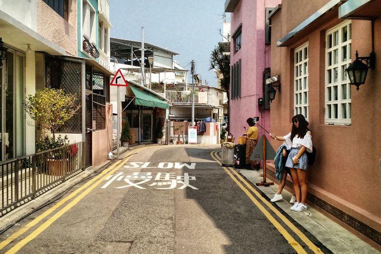 Tourist girls taking selfies. EyeEm Selects City Full Length Women Road Walking Road Sign Street City Life Text Lane Road Marking Non-western Script