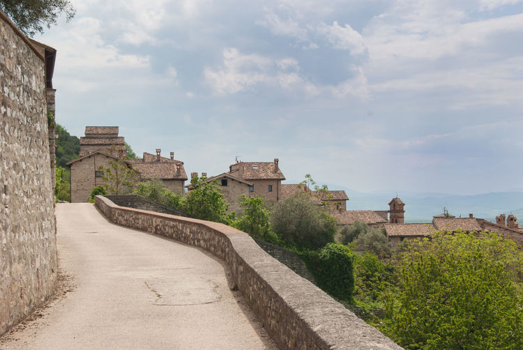 Gubbio, Perugia, Italy Pedestrian Walkway Umbria, Italy Ancient Ancient Civilization Architecture Building Building Exterior Built Structure Cloud - Sky Day Direction Footpath History Italy Nature No People Old Outdoors Sky The Past The Way Forward Travel Travel Destinations Tree