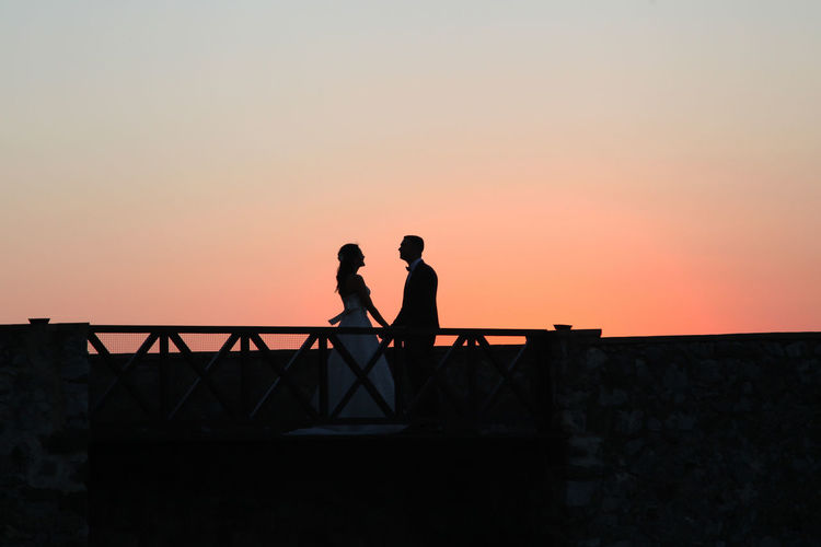 Wedding Wedding Photography Adult Adults Only Architecture Beauty In Nature Built Structure Clear Sky Day Men Nature Outdoors People Railing Real People Silhouette Sky Standing Sunset Togetherness Two People Wedding Ceremony Wedding Day Wedding Dress Women EyeEmNewHere