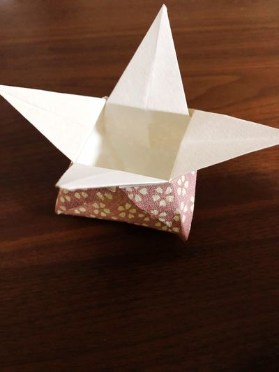 Paper Art And Craft Craft No People Table Indoors  Creativity Close-up Folded Triangle Shape Single Object Brown White Color High Angle View Tissue Paper Still Life Craft Product Origami Studio Shot Shape
