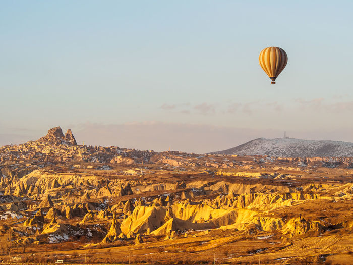 Sky Scenics - Nature Air Vehicle Hot Air Balloon Beauty In Nature Environment Landscape Nature Travel Non-urban Scene Tranquil Scene Mid-air Mountain Balloon Rock Rock Formation Travel Destinations Tourism Rock - Object Tranquility No People Outdoors Arid Climate Climate