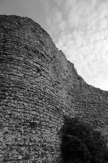 Old Curved Castle Wall Low Angle View Sky Cloud - Sky Day Nature Rock Solid Tranquility Outdoors Rock - Object Textured  Plant Rough Stone Wall Castle Castle Walls Blackandwhite Black And White