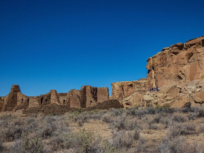 Rock formations on landscape against clear blue sky