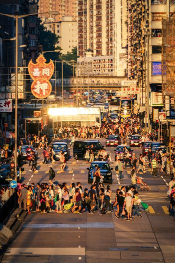 Sunset Reframinghk cityscapes Streetphotography Discoverhongkong City Architecture Building Exterior Street Built Structure Large Group Of People Crowd Group Of People Transportation City Street City Life Real People Walking Illuminated Car Night Road Mode Of Transportation Men Outdoors