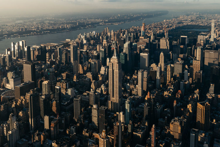 High angle view of modern buildings in city empire state building