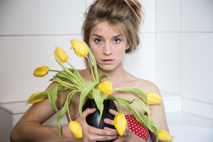 Portrait One Person Young Adult Front View Holding Indoors  Looking At Camera Young Women Lifestyles Fruit Healthy Eating Beauty Food Women Food And Drink Real People Wellbeing Yellow Freshness Beautiful Woman Hairstyle Flower Dayafter