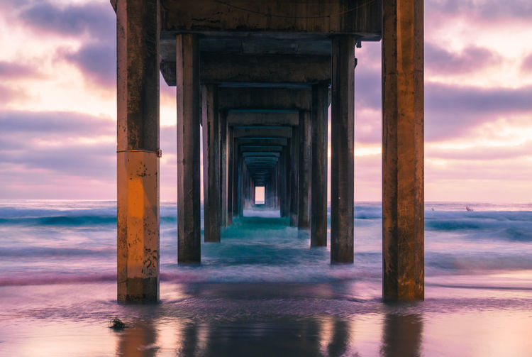 Architectural Column Architecture Beach Beauty In Nature Built Structure Cloud - Sky Column Diminishing Perspective Horizon Over Water In A Row Long Nature Pier Scenics Sea Shore Sky Sunset SUPPORT The Way Forward Tranquil Scene Tranquility Vacations Water Wave