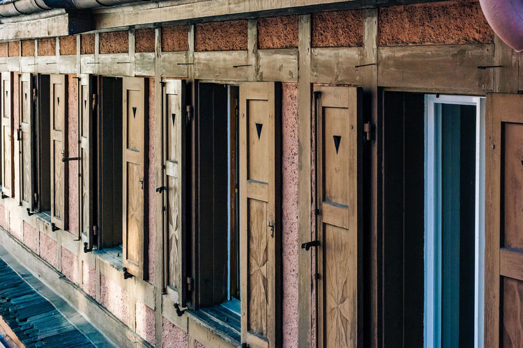 Abandoned Bad Condition Brown Closed Door Doorway Entrance Exterior House Indoors  No People Obsolete Old Order Text Wall Wood Wood - Material Wooden