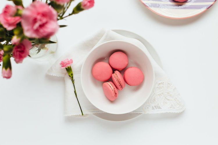 High angle view of pink roses in plate on table