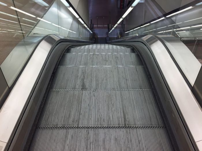 Escalator Architecture Built Structure Modern Staircase Railing Steps Indoors  Futuristic Steps And Staircases Moving Walkway  The Way Forward Convenience Illuminated Moving Down No People Technology Futuristic Lines Modern Airport Iphone6 Perspective Reflection