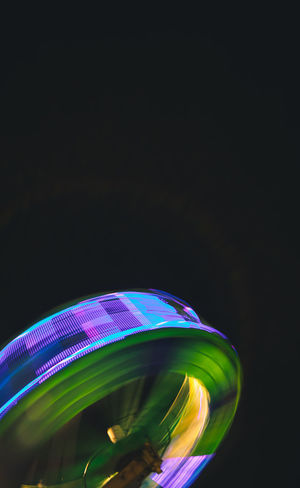Carnival Singapore Abstract Arts Culture And Entertainment Black Background colour of life Copy Space Glowing Illuminated Long Exposure Low Angle View Motion Multi Colored negative space Night No People Ride Shape Single Object Spinning Still Life