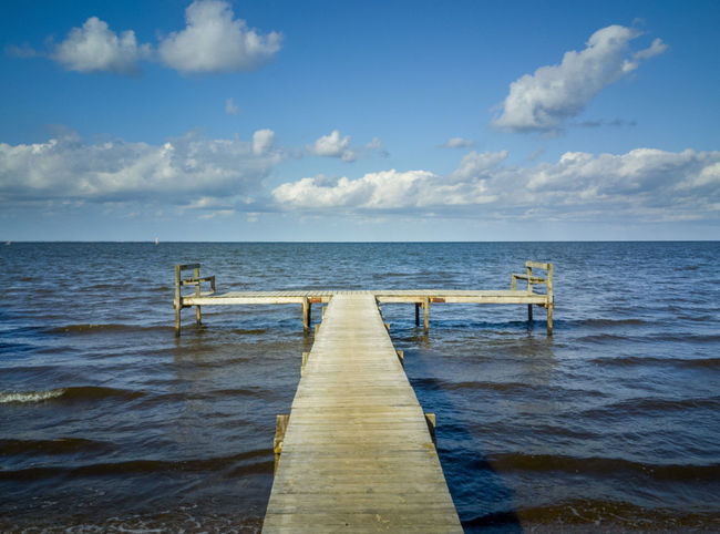 Beauty In Nature Cloud - Sky Day Direction Horizon Horizon Over Water Jetty Long Nature No People Outdoors Pier Scenics - Nature Sea Sky The Way Forward Tranquil Scene Tranquility Water Wood - Material Wooden Post