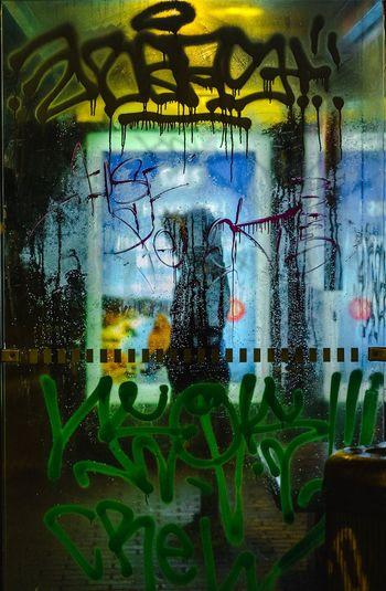 Close-up of text on graffiti