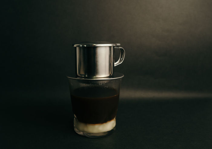 Vietnamese Coffee Drink Food And Drink Refreshment Indoors  Studio Shot Still Life Glass Household Equipment Table Close-up No People Drinking Glass Coffee Coffee - Drink Freshness Single Object Black Background Glass - Material Metal Transparent