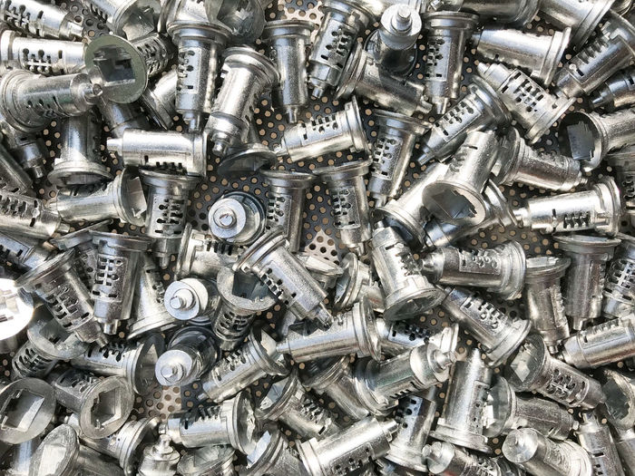 Key components Made of zinc For the key manufacturing industry. Abundance Aluminum Backgrounds Close-up Components Day Full Frame Heap Industry Key Large Group Of Objects Manufacturing Metal No People Nut - Fastener Outdoors Scrap Metal Silver - Metal Zinc