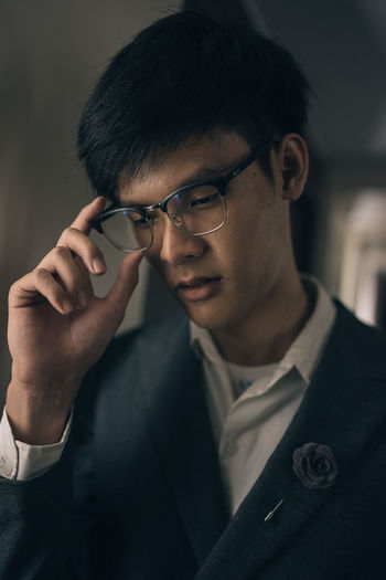 Close-up of young man wearing eyeglasses
