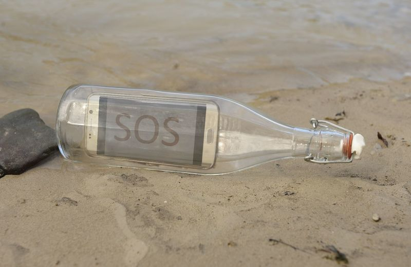 Sand Beach No People Outdoors Close-up Day Smartphone Communication Water Message Sos Bottle Message In A Bottle Mobile Smart Phone Help Me Save Our Souls Business Finance And Industry Help Bottle Mail My Work My Design Own Creation Modern Communication