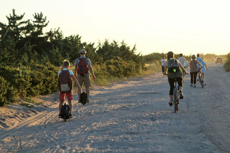 Fire Island Unicycle Adventure Bicycle Cycling Headwear Healthy Lifestyle Lifestyles Outdoors Real People Rear View Riding Sports Clothing Sports Race Togetherness Transportation