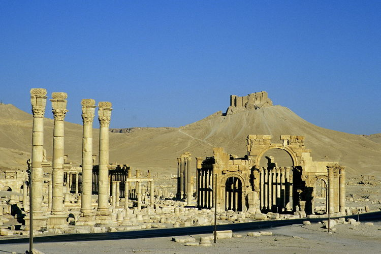 Palmyra before the civil war. Antiquity Arch Of Septimius Severus Arch Of Triumph Architecture Building Exterior Built Structure Clear Sky Day Fakhr-al-Din Al-Ma'ani Castle Monumental Arch No People Outdoors Palmyra Palmyra Castle Palmyra Ruins Roman Roman Antiquity Ruins Sky Syria  Tadmor