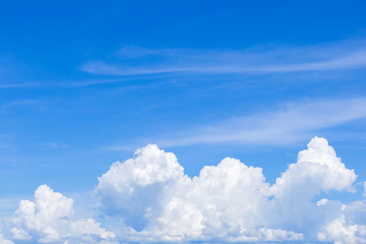 Blue sky with white clouds, rain clouds on sunny summer or spring day for background design. Beautiful Bright Clear Sky Cloud Cloudscape Heaven Light Nature View Weather Air Background Backgrounds Beauty In Nature Blue Cloud - Sky Cloudscape Color Cumulus Day Environment Fluffy Full Frame High Angle View Idyllic Low Angle View Meteorology Nature No People Outdoors Pattern Scenics Scenics - Nature Sky Softness Summer Sunlight Tranquil Scene Tranquility White White Color