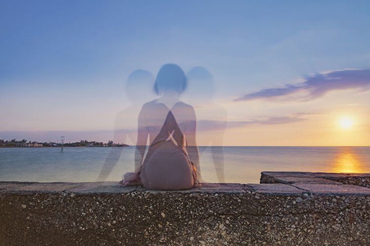 LNF files Woman Young Women Long Exposure Motion Feelings Drama Beauty From Behind Seating Waterfront Water Sea Beach Sunset Sky Horizon Over Water Calm Shore Tranquil Scene Scenics Tranquility Idyllic Coast Non-urban Scene