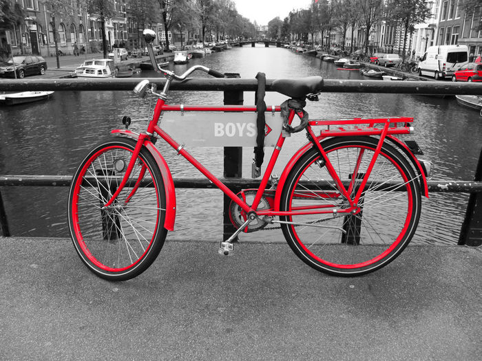 Bicycle parked by river in city