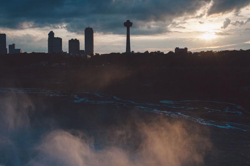 Waterfall Against Buildings In City