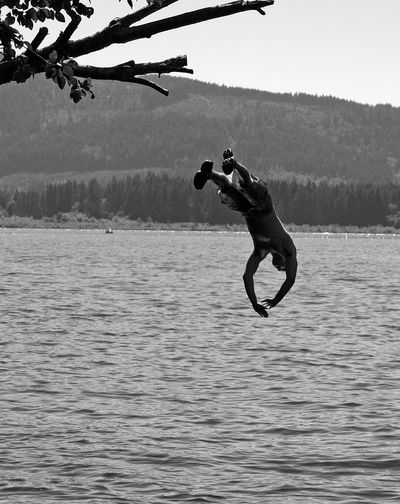 Man diving in to lake