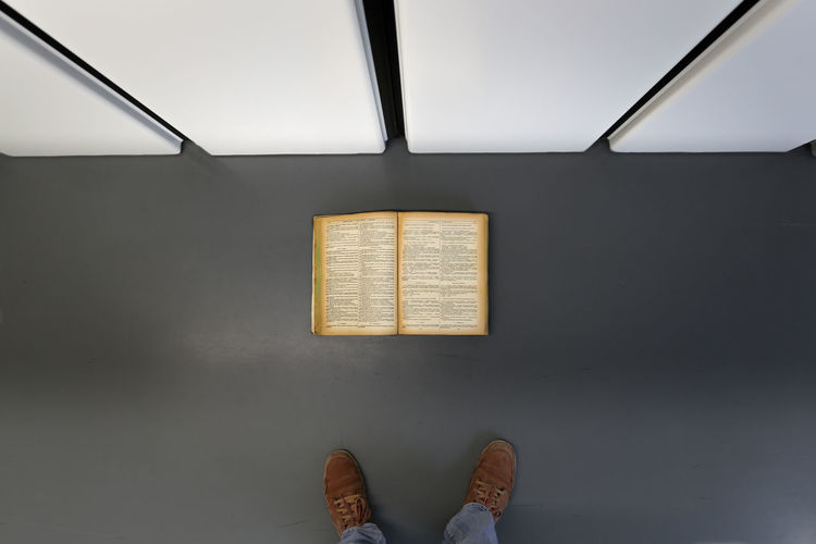 Book Books Communication Control Copy Space Design Directly Above Indoors  Lines Look Down Occupation Old Book On The Ground Shoe Simple Photography Simplicity Single Object Still Life Technology Wall Wall - Building Feature
