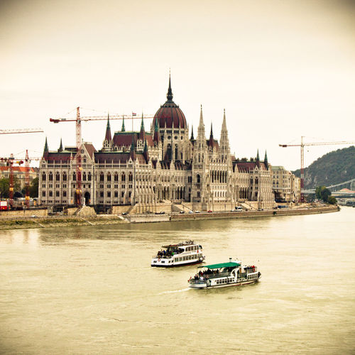 Architecture Bridge - Man Made Structure Budapest Parliament Budapest, Hungary Building Exterior Built Structure Chain Bridge City Clear Sky Crane - Construction Machinery Day Dome Mode Of Transport Nature Nautical Vessel No People Outdoors Place Of Worship River Sky Transportation Travel Destinations Water Waterfront