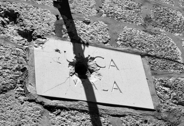 Blackandwhite Bullet Holes Shadow Street Sign Wall