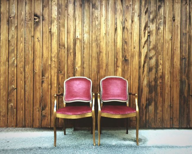 Chairs In Front Of Wooden Wall Panel