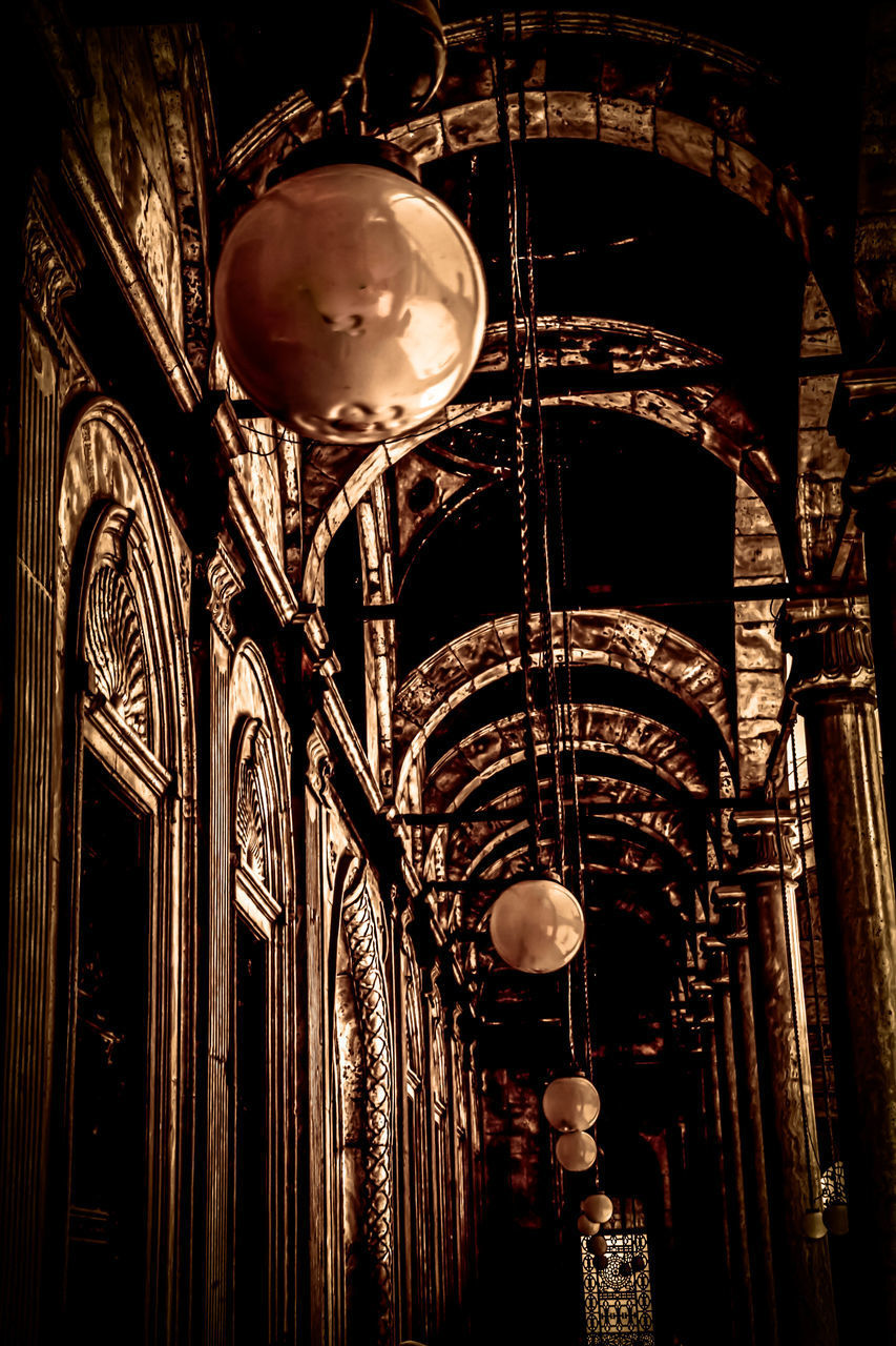 architecture, lighting equipment, built structure, low angle view, no people, hanging, building, illuminated, building exterior, arts culture and entertainment, the past, history, sphere, tourism, travel destinations, decoration, metal, night, arch, architectural column, ornate, ceiling, electric lamp