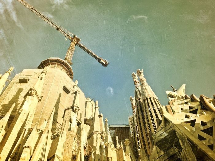 Low Angle View Architecture Built Structure Building Exterior Development Spirituality Religion Crane - Construction Machinery Church History Sagrada Familia Barcelona Vintage Photo Temple Outdoors Sky Day Tall Architectural Feature Crane Architectural Column Cloud - Sky Spire  IPhoneography Grunge_effect