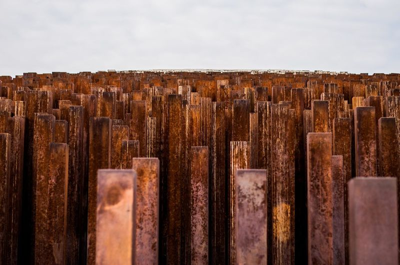 Close-Up Of Posts Against Sky