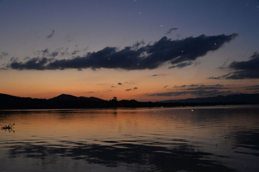 A very buggy night - African bugs Sunset Beauty In Nature Sky Nature Water Silhouette Scenics Reflection Tranquility Tranquil Scene Lake Mountain Outdoors Hartbeespoort Dam Hartebeespoort South Africa Star - Space