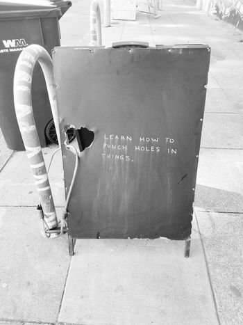 Punch holes in things if you know how lol. Daytime Photography Black & White Bllack And White Photography Street Art/Graffiti Streetphotography Urban Art Oakland, Ca. California