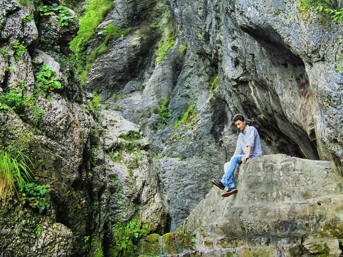 Seeking adventure, escaping life.. Rock - Object One Person Full Length Casual Clothing Day Leisure Activity Outdoors High Angle View Real People Nature Climbing Rock Climbing Young Adult Lifestyles Young Women Sitting Tree Mountain Adult People Hiking Travel Traveling Pakistan Adventure