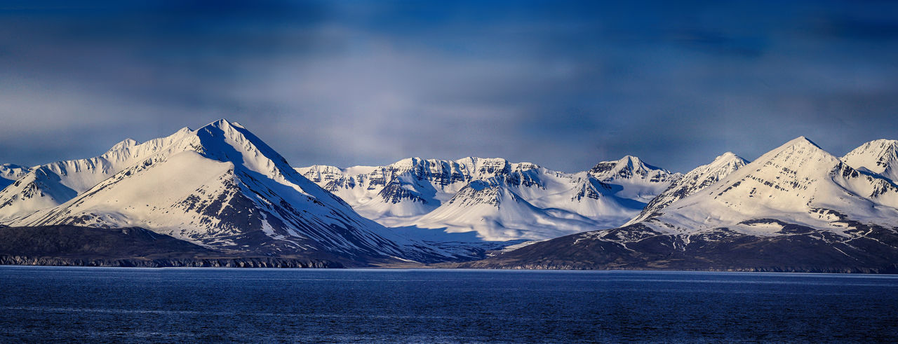 Shoreline near Akureyri in Iceland Calm Iceland Panoramic Rugged Tranquility Winter Mountains Peaceful Sea Shoreline Snow