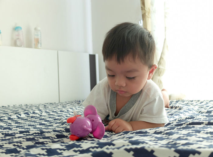 Cute boy playing toy. Fun Toy Playing Baby Cute Child Portrait Young Face Kid Innocence Adult Happy