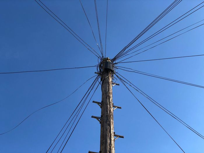 Wired Low Angle View Sky Blue Clear Sky No People Connection Cable Technology Electricity  Power Line  Pole