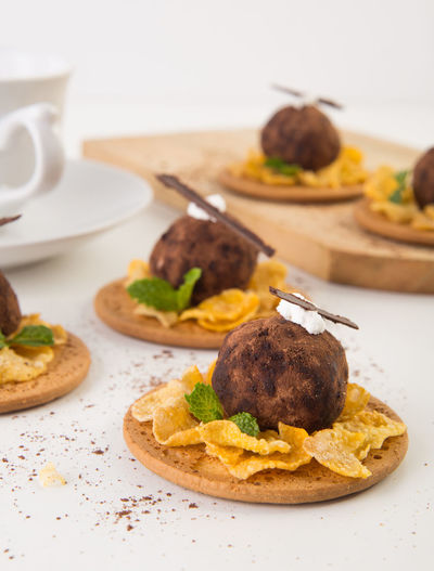 Close-up of chicken balls with corn flakes