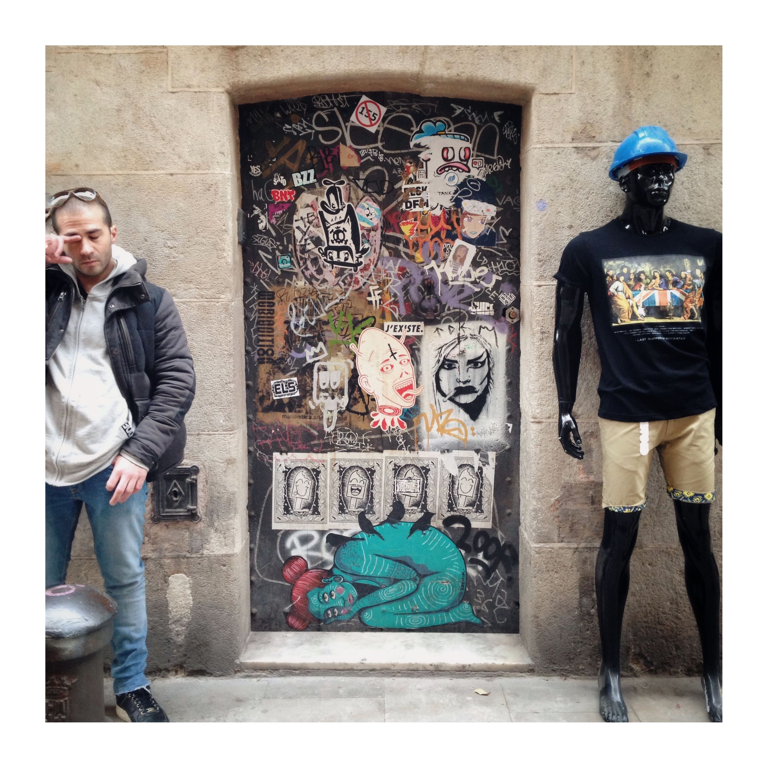 graffiti, standing, casual clothing, real people, young men, one person, full length, young adult, fashion, day, portrait, front view, looking at camera, outdoors, men, building exterior, lifestyles, architecture, adult, people