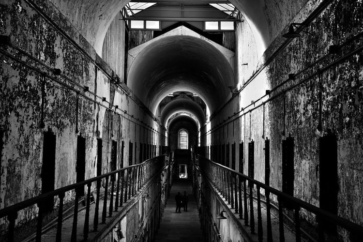 Haunted - Eastern State Penitentiary Pennsylvania Philadelphia Architecture No People The Way Forward Indoors  Day Blackandwhite Modern Low Angle View Portrait Sky Travel Travel Destinations Streetphotography Architecture Downtown Fujifilm_xseries Straightfromcamera Figures Mystery Ghost Ghost Town Urban Skyline Built Structure