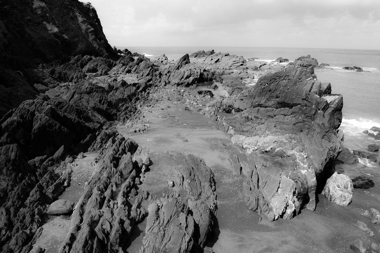 Black & White Coastline Rock Beach Beauty In Nature Black And White Black And White Friday Cliff Dramatic Landscape Horizon Over Water Landscape Nature No People Outdoors Physical Geography Rock Rock - Object Rock Formation Scenics Sea Sky Texture Tranquil Scene Tranquility Water