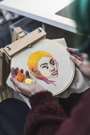 High angle view of woman holding painting