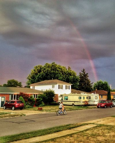 Somewhere, under the rainbow. Outdoors Sky And Clouds Neighborhood Suburbia Bicycle Rainbow Street Landscape Golden Hour Lone Figure Bicyclist