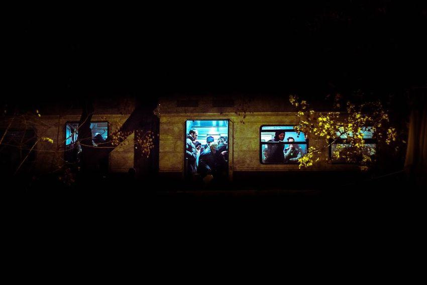 Architecture Built Structure Illuminated Indoors  Men Night People Real People Subway Train Window