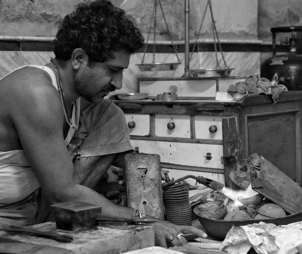 A silver smith forges bracelets in the back streets of jodhpur India Snapshots Of Life Noir People Photography People Traveling Streetphotography Streetphoto_bw Backstreets & Alleyways
