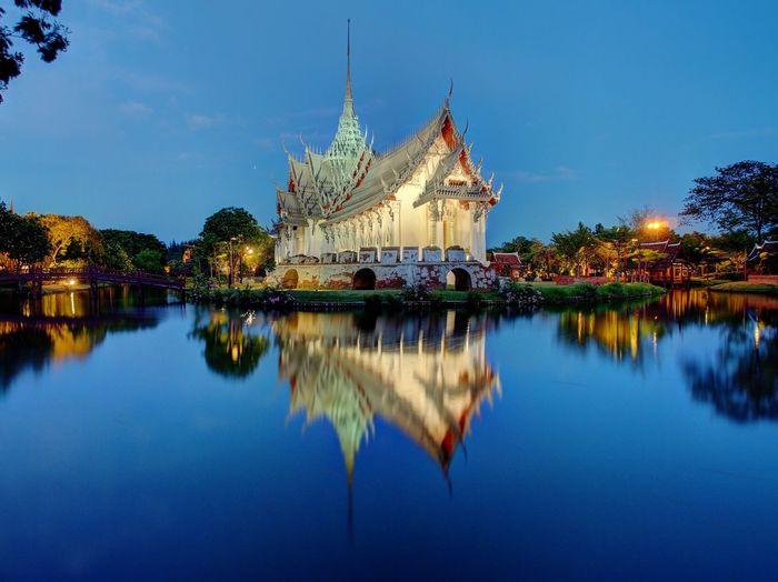 Sanphet prasat palace by river against blue sky
